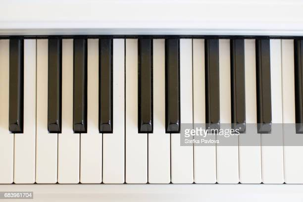 digital piano keys close-up - keyboard instrument stock photos and pictures