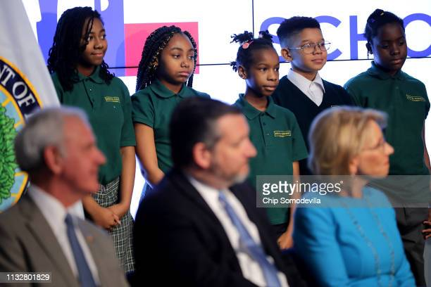 Digital Pioneers Academy students stand behind US Education Secretary Betsy DeVos Sen Ted Cruz and Rep Bradley Byrne during an event to promote their...