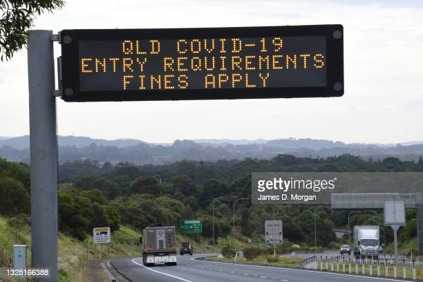 Digital road signs warn drivers of entry requirements to cross the NSW-Queensland border on June 24, 2021 in Byron Bay, Australia. COVID-19...