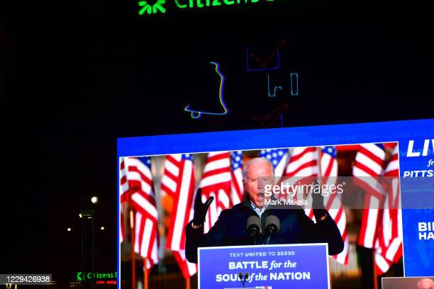 Digital screen displays a speech by Democratic presidential nominee Joe Biden during a a drive-in election eve rally with Democratic vice...