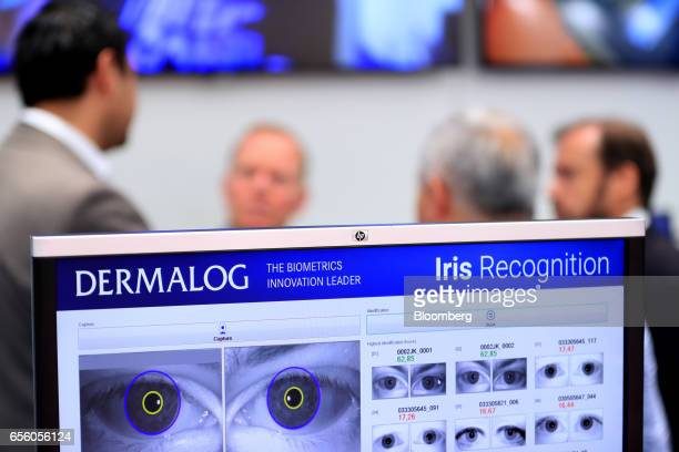 A digital screen displays iris scans to demonstrate the operation of an iris recognition scanning system at the Dermalog Identification Systems GmbH...