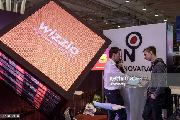 A digital screen promotes the Wizzio digital banking platform operated by Novabase SGPS SA at the Lisbon Web Summit in Lisbon Portugal on Tuesday Nov...