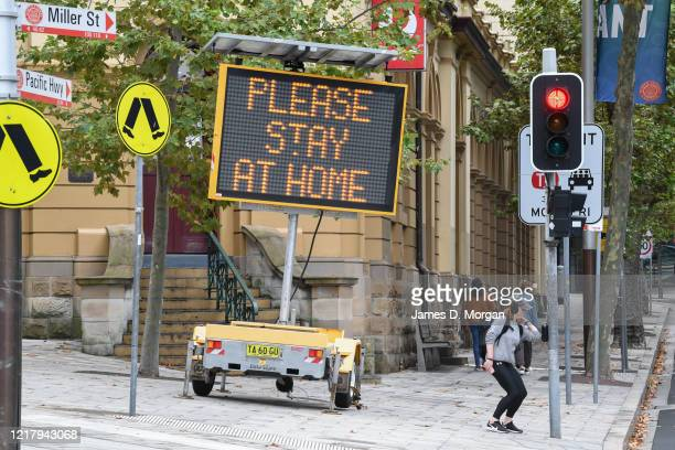 Digital sign warning people to stay at home, wash their hands and remain apart from the person next to them in North Sydney's CBD on April 10, 2020...