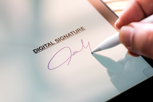 Digital Signature Concept with Tablet and Stylus Pen 955965828