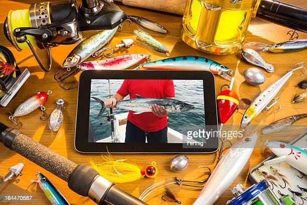 Digital tablet and fishing tackle still-life