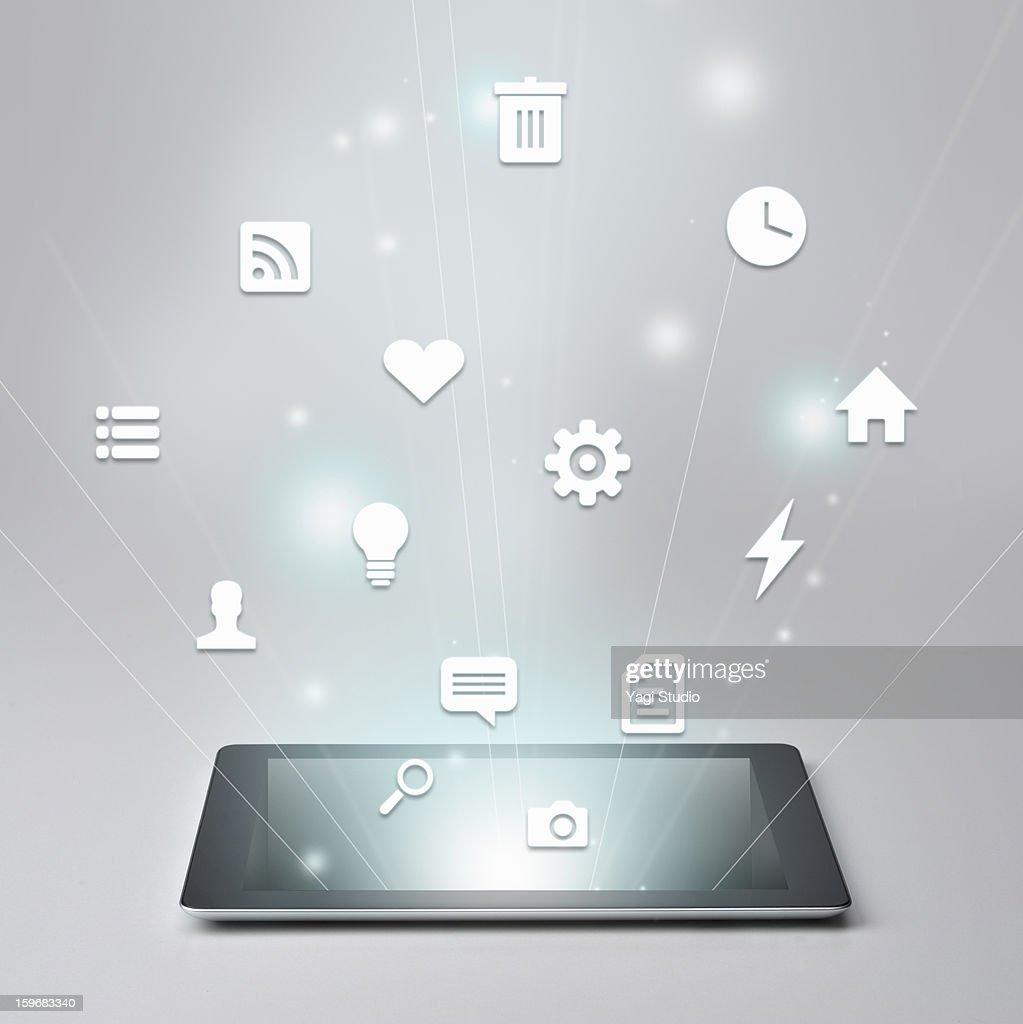 Digital tablet and Variety of icons : Bildbanksbilder