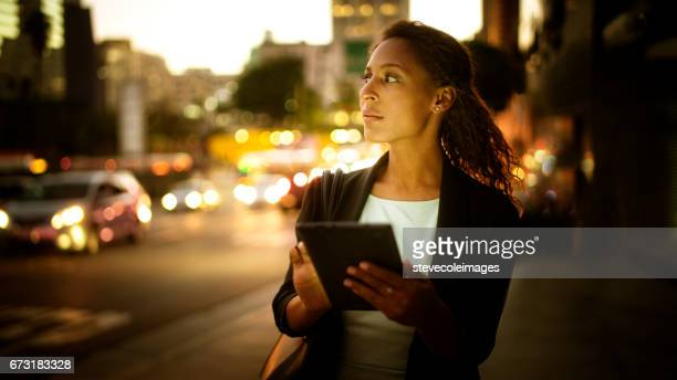 Digital tablet at night in the city.