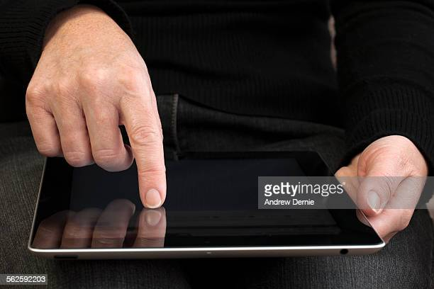 digital tablet computer - andrew dernie stock pictures, royalty-free photos & images