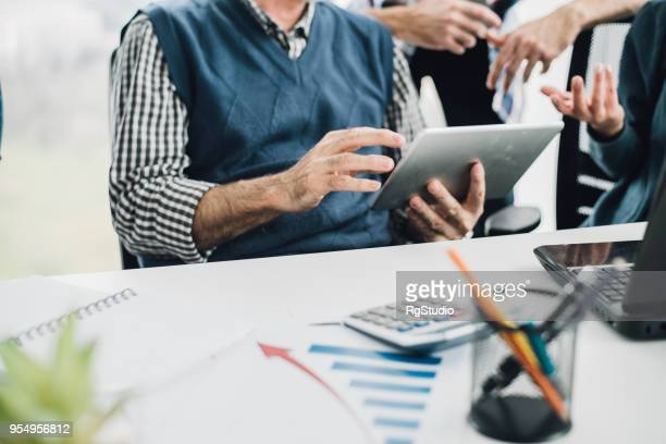 digital tablet in hand - obscured face stock pictures, royalty-free photos & images