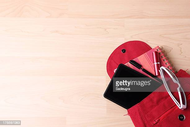 digital tablet in  woman's bag backpack - help:contents stock pictures, royalty-free photos & images