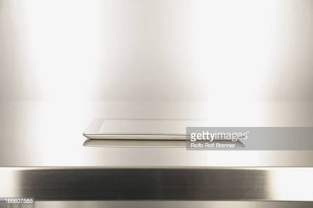 Digital tablet on a metal table
