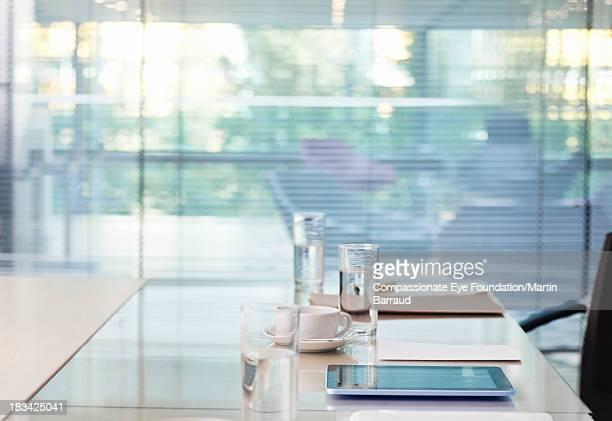 Digital tablet on desk in modern office