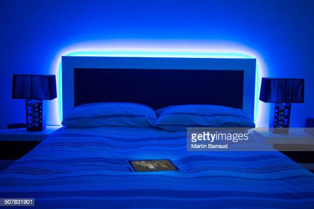 digital tablet on glowing bed