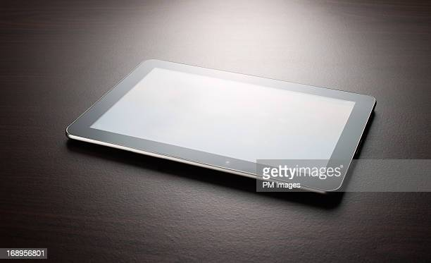 Digital tablet on table top