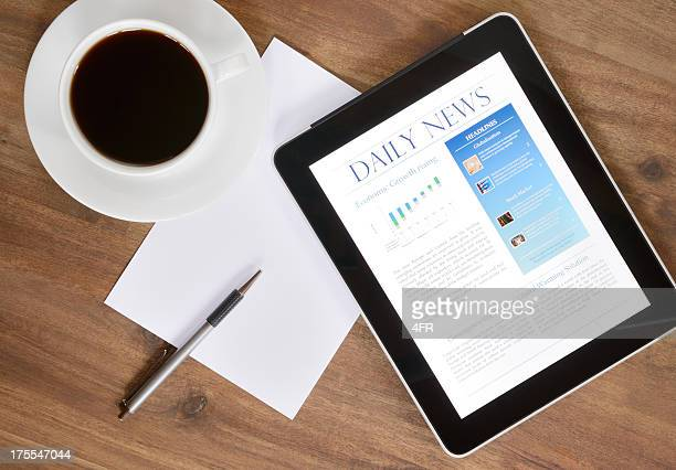 digital tablet pc with news on desk (xxxl) - publication stock pictures, royalty-free photos & images
