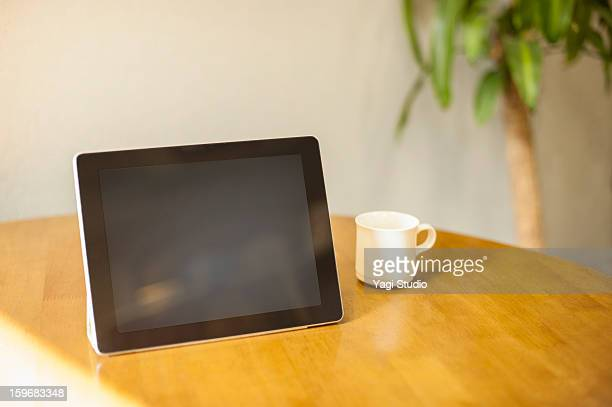 Digital tablet with Coffee cup