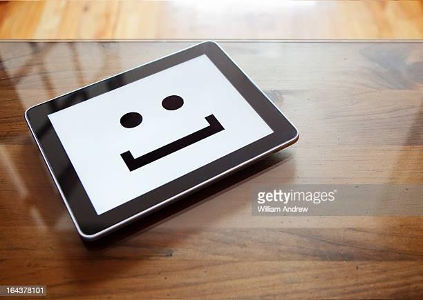 Digital tablet with smile emoticon