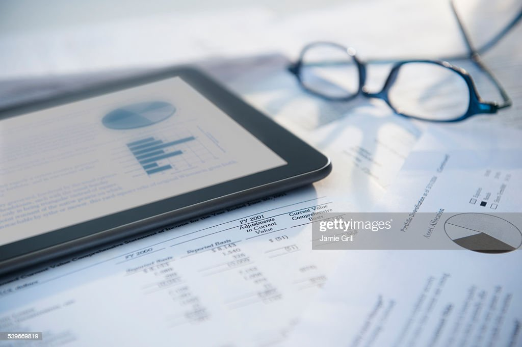 Digital tablet with stock market data : Stock Photo