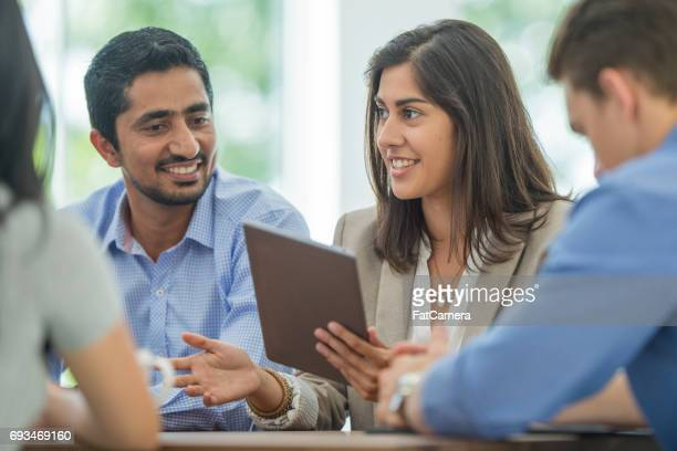 digital technology in a business meeting - indian ethnicity stock pictures, royalty-free photos & images