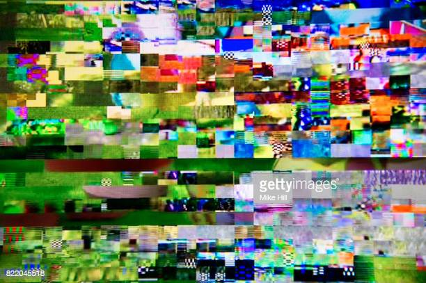 digital television interference pattern - glitch art stock photos and pictures