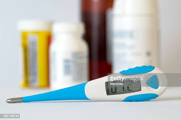 digital thermometer and medication - high up stock pictures, royalty-free photos & images