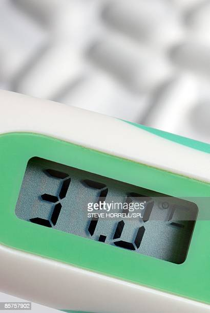 digital thermometer displaying normal body temperature, 37 degrees celsius - digital thermometer ストックフォトと画像