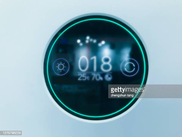 digital thermostat on blue light background - control stock pictures, royalty-free photos & images