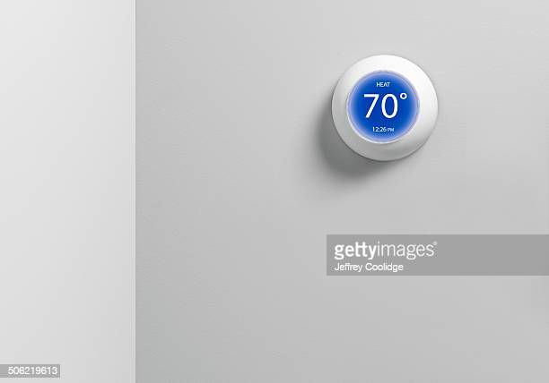 digital thermostat round - thermostat stock photos and pictures