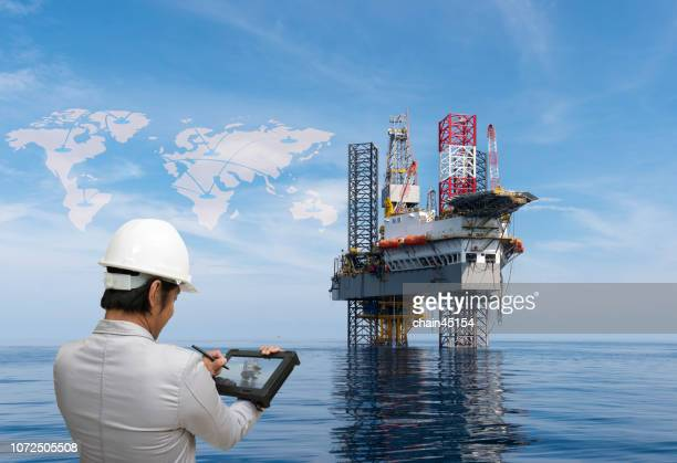 digital transformation with engineer work with tablet for oil and gas industry drilling operation on the platform - construction platform stock pictures, royalty-free photos & images