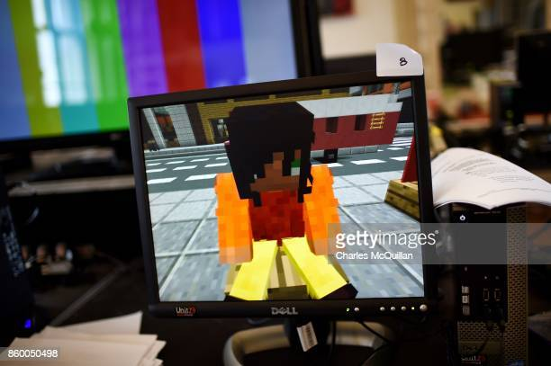 A digital version of the character 'Sal' sits in the virtual Minecraft world created by the backstage digital team during a 'Playcraft' live...