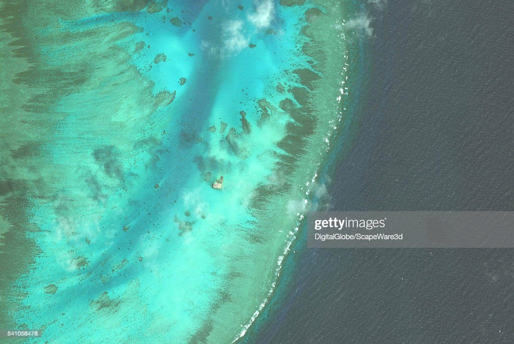 DigitalGlobe overview imagery of Johnson South Reef. (Image 1 of 2 of sequence.) It is also known as Chigua Reef, Yongshu Reef, Gc Ma Reef and Mabini Reef and is located in the southwest portion of Union Banks, in the Spratly Islands of the South China Sea. Photo DigitalGlobe via Getty Images.