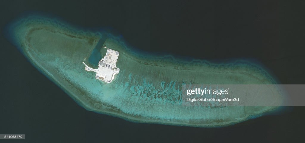 DigitalGlobe overview imagery of one of the Cuarteron Reef. (This is image 3 of 3 of the before-after sequence.) The Cuarteron Reef is located at the east end of the London Reefs in the Spratly Islands of the South China Sea. Photo DigitalGlobe via Getty Images.