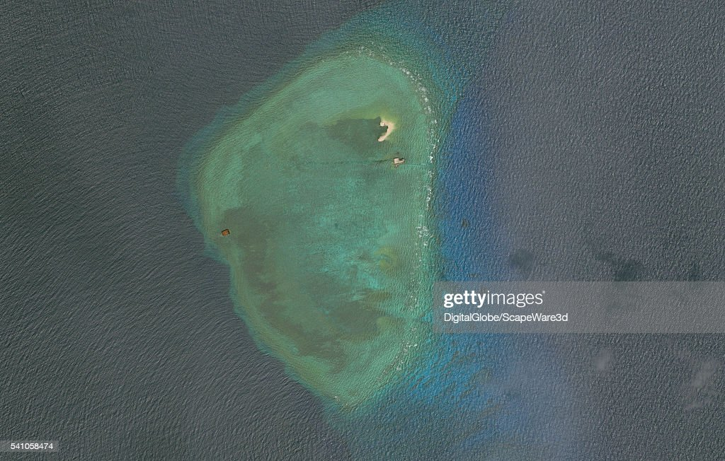 DigitalGlobe overview imagery of one of the Gaven Reefs. (Image 1 of 2 of sequence.) The Gaven Reefs are located in the Tizard Bank of the Spratly Islands in the South China Sea. Photo DigitalGlobe via Getty Images.