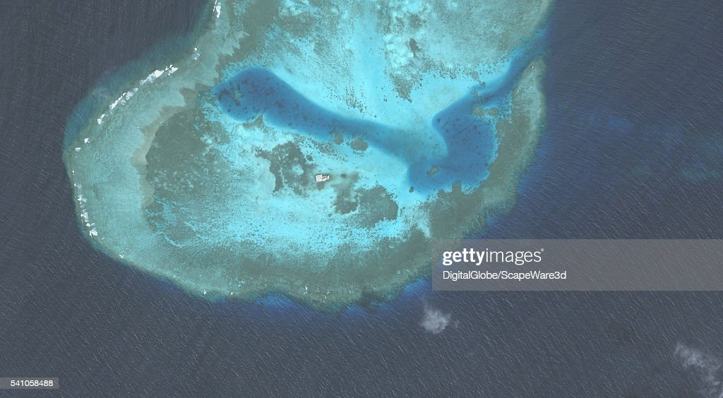 DigitalGlobe overview imagery of one of the Hughes Reefs. (Image 1 of 2 of sequence.) The Hughes Reef is located in the Union banks area within the Spratly group of islands in the South China Sea. Photo DigitalGlobe via Getty Images.