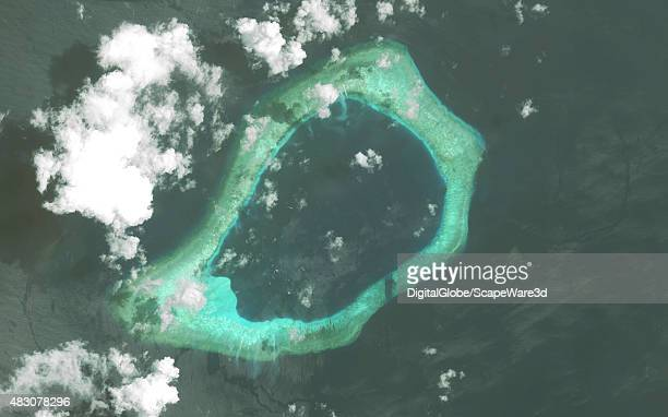 DigitalGlobe via Getty Images imagery of the Subi Reef in the South China Sea a part of the Spratly Islands group Image progression of 3 Photo...
