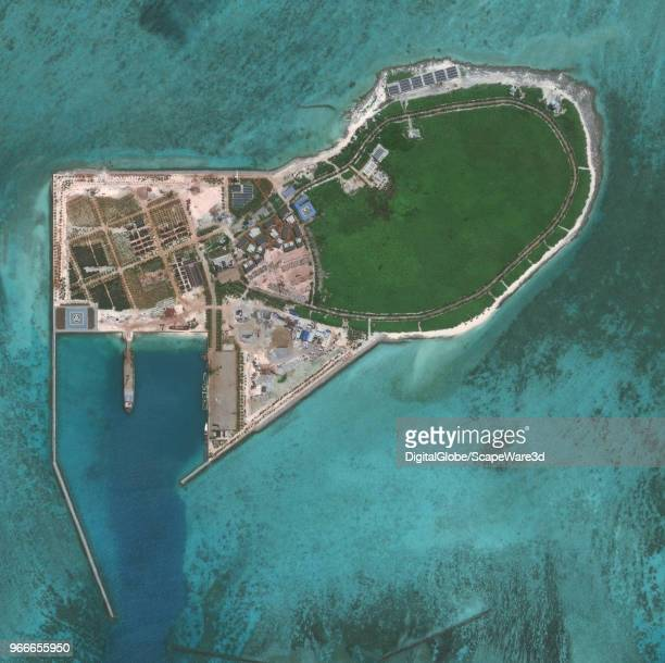 DigitalGlobe via Getty Images imagery of Tree Island. Tree Island is one of the main islands of the Paracel Islands group in the South China Sea....