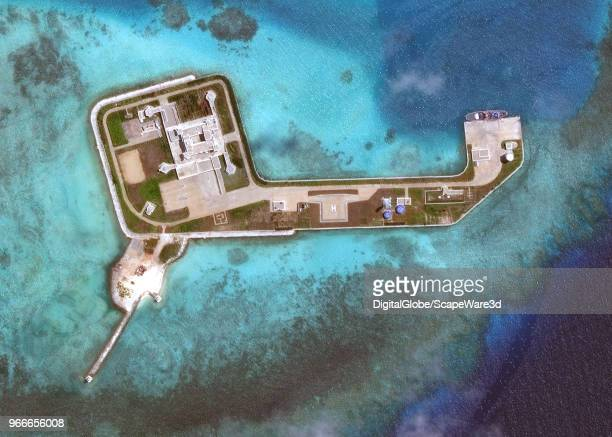 DigitalGlobe via Getty Images overview imagery of one of the Hughes Reefs. The Hughes Reef is located in the Union banks area within the Spratly...
