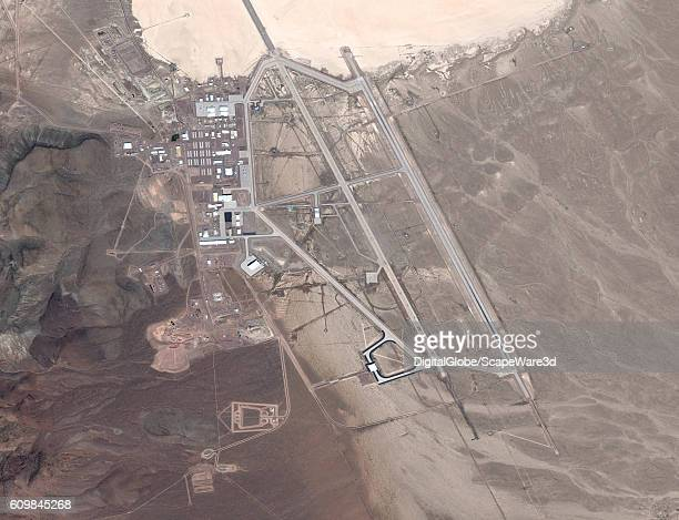 DigitalGlobe via Getty Images satellite image Area 51. The United States Air Force facility commonly known as Area 51 is a remote detachment of...