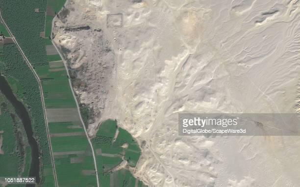 DigitalGlobe via Getty Images satellite image shows a dramatic increase in looting holes at archiological site Photo DigitalGlobe via Getty Images...