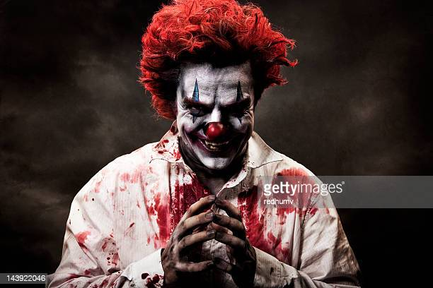 digitally altered image of evil, bloody clown - spooky stock pictures, royalty-free photos & images