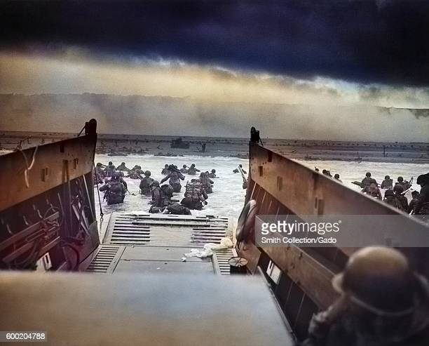 Digitally colorized image of Into the Jaws of Death a photograph by Robert F Sargent of the United States Army First Infantry Division disembarking...