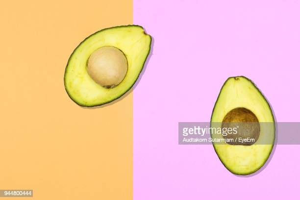 Digitally Generated Image Of Avocado On Colored Background