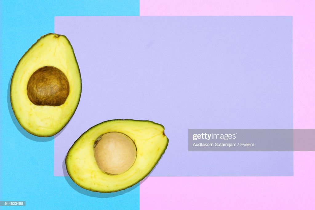Digitally Generated Image Of Avocado On Colored Background : Stock Photo