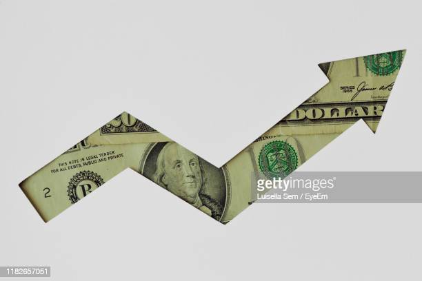 digitally generated image of dollar against white background - arrow symbol stock pictures, royalty-free photos & images