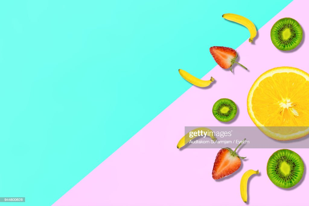 Digitally Generated Image Of Fruits On Colored Background : Stock Photo