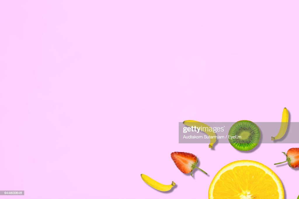 Digitally Generated Image Of Fruits On Pink Background : Stock Photo