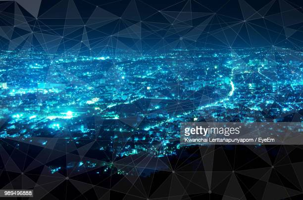 Digitally Generated Image Of Global Communications Ad Illuminated Cityscape At Night
