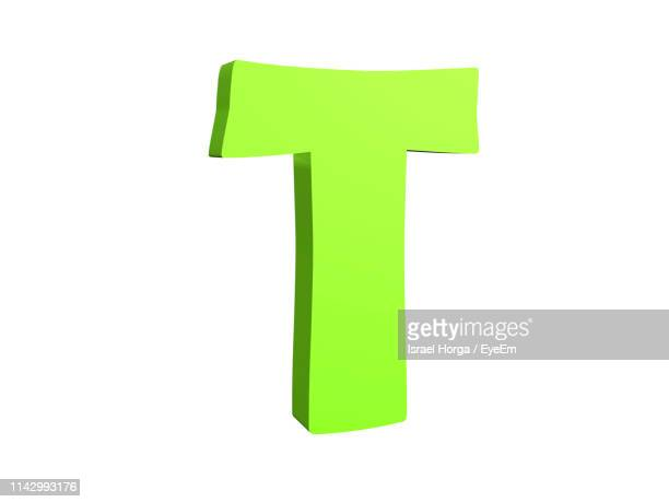 digitally generated image of green letter t against white background - letter t stock pictures, royalty-free photos & images