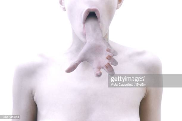 digitally generated image of hand coming out from woman mouth - viola cappelletti foto e immagini stock