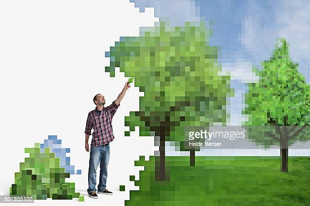 Digitally generated image of man deconstructing or building green landscape